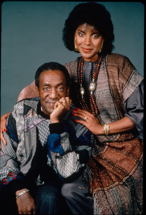 Bill Cosby and Phylisha Rashad strike a pose