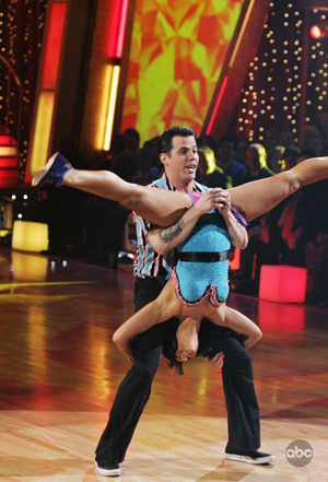 Stevo has Lacey turned upside down on DWTS