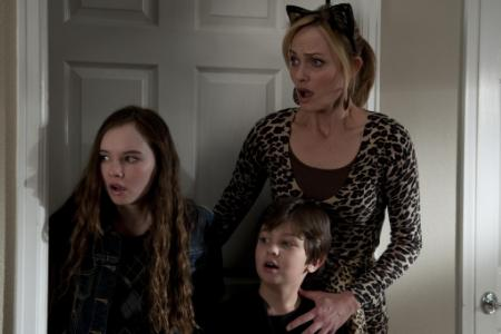 The Spy Next Door stars Amber Valletta as a mom of three kids in need of saving by Jackie Chan