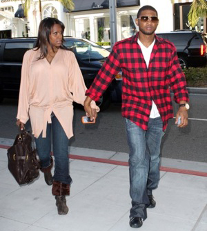 Usher and his wife out for a stroll