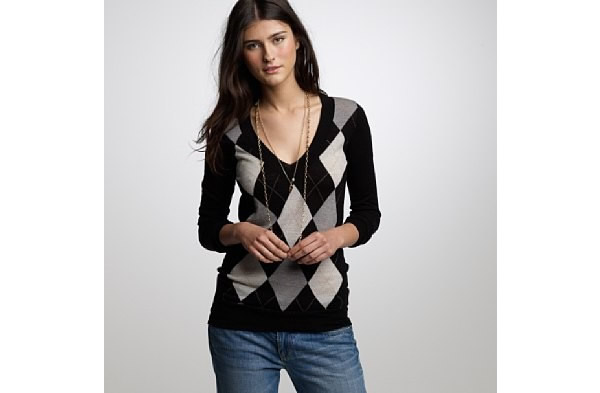 5fc6388e9d0 working mom wearing v neck sweater