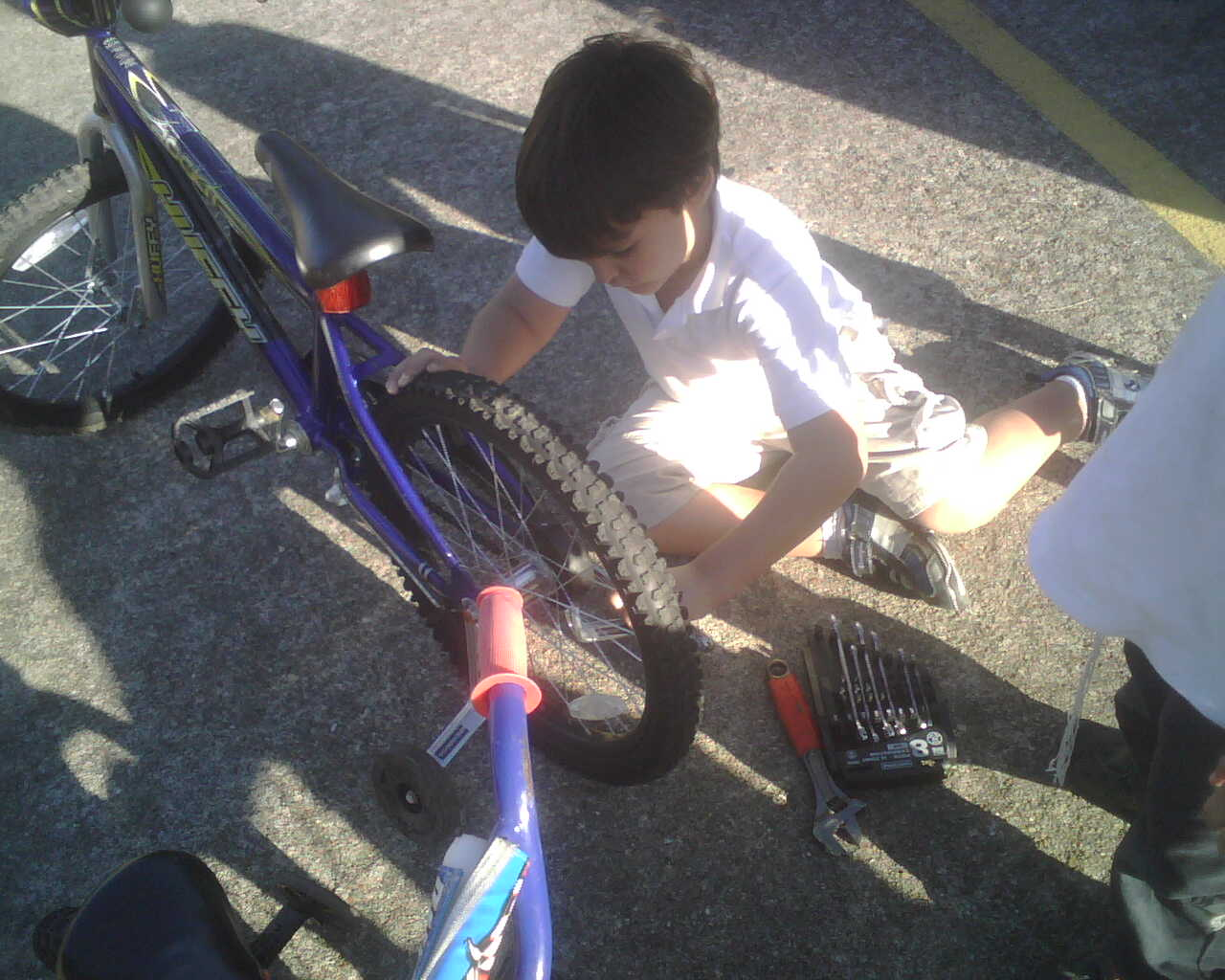 My son working on his bike.