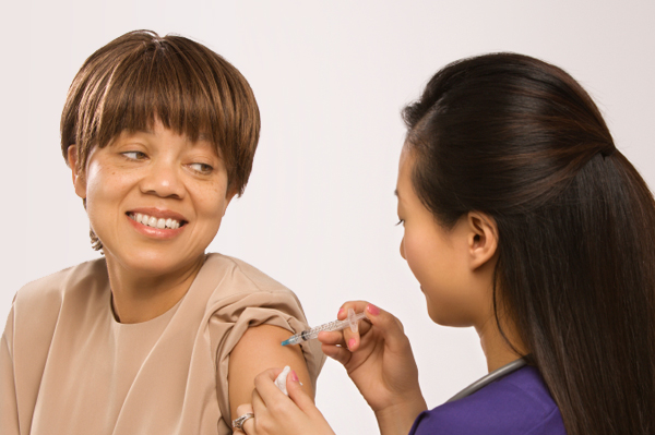 Adult woman getting vaccine