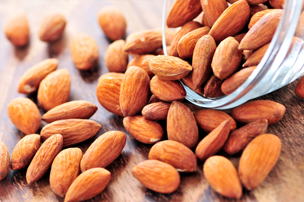 Almonds spilling from bowl