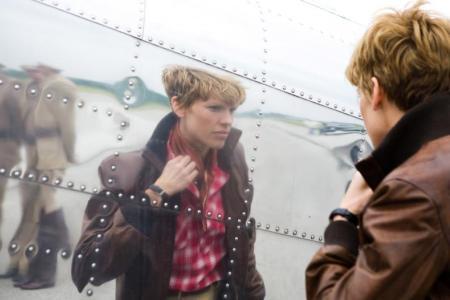 Hilary Swank as Amelia checks herself pre-flight
