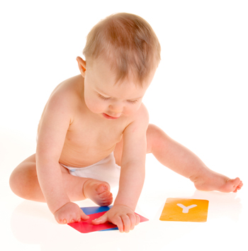 baby playing with letter cards