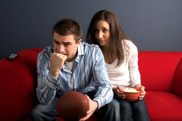 Bored woman watching football