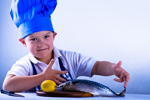 Boy preparing fish for dinner