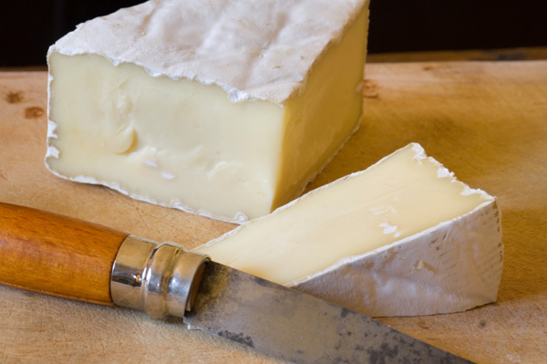 Brie on cutting board