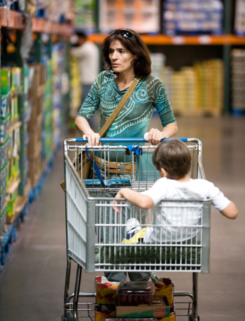 woman pushing shopping cart