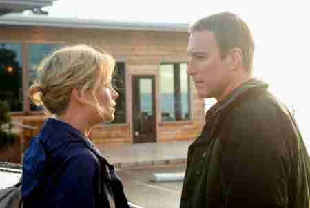 Theron and John Corbett in The Burning Plain