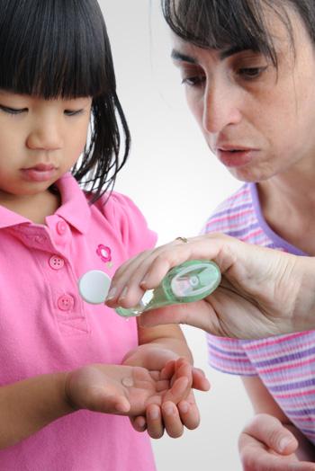 Child Applying Hand Santizer