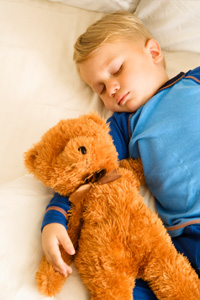 Child sleeping with teddybear