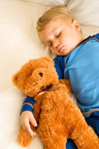 Child sleeping with teddybear