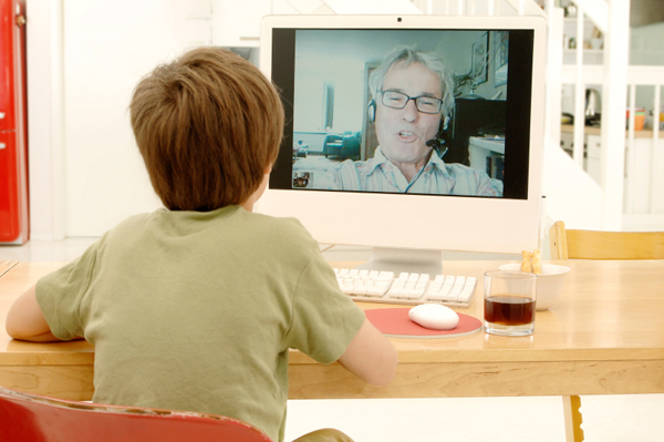 Child web-caming with father