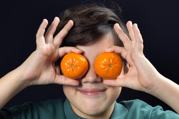Young Boy with Clementines