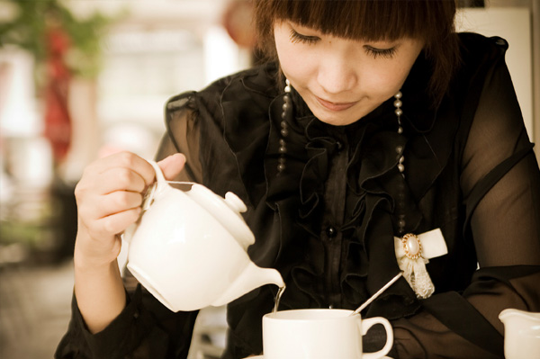 Chinese woman drinking tea