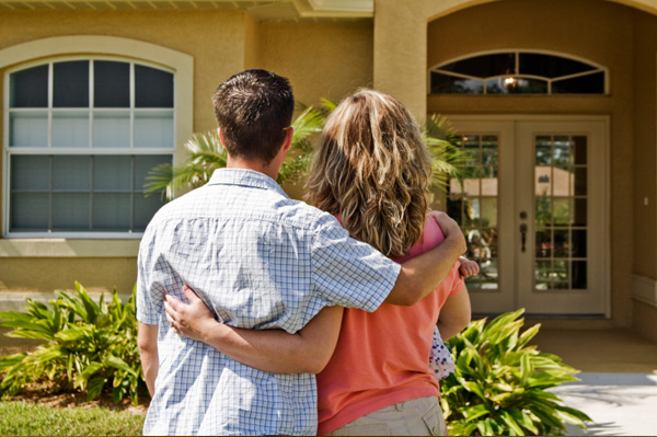 Couple in Front of First Home