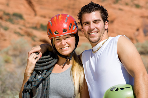 Couple in rock climbing gear