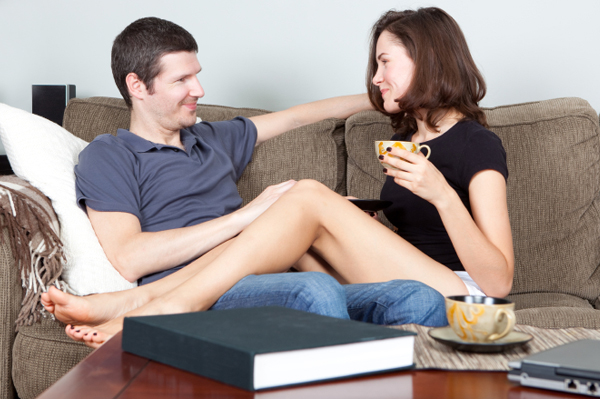 Couple Smiling on Couch