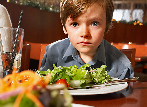 Boy with autism eating out at a restaurant