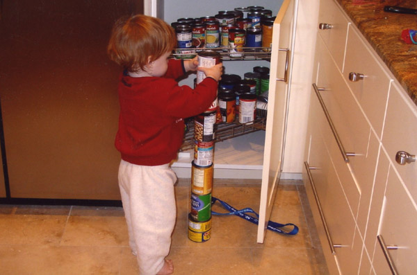 Little boy with autism stacking cans - pic by his mama, Nancy J Price