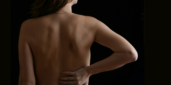 Woman with backpain.