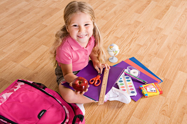 Girl withSchool supplies (sheknows.com)