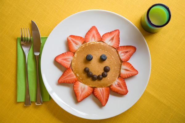 Smiley Face made out of Pancakes and Berries