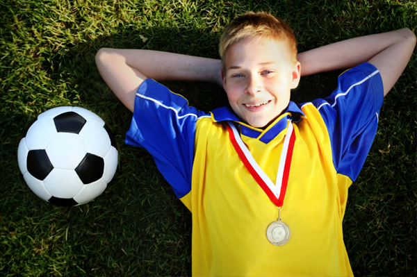 Boy with Soccer Award