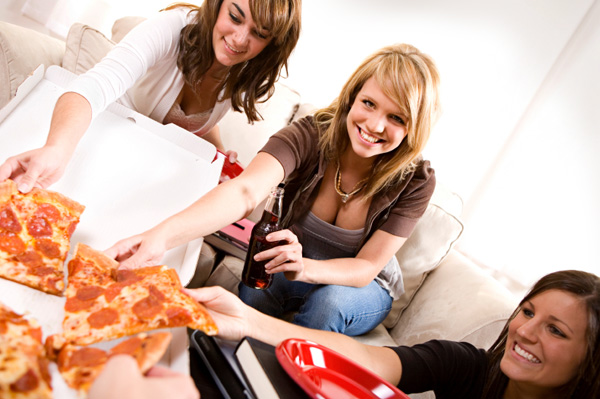 College Girls eating Pizza