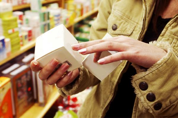 Woman Looking at Cosmetics Box