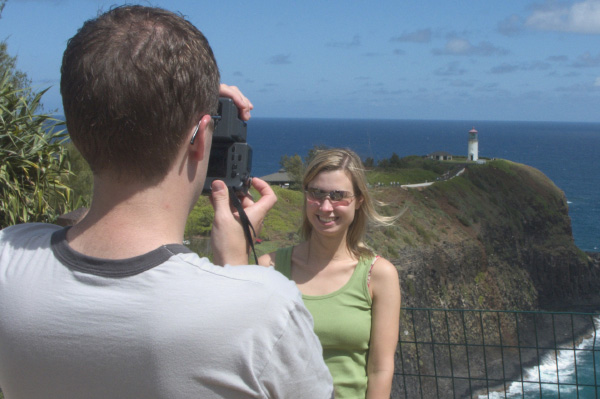 man taking picture of woman on vacation