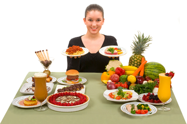 woman standing in front of table full of food