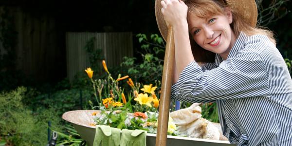 Women gardener in yard.