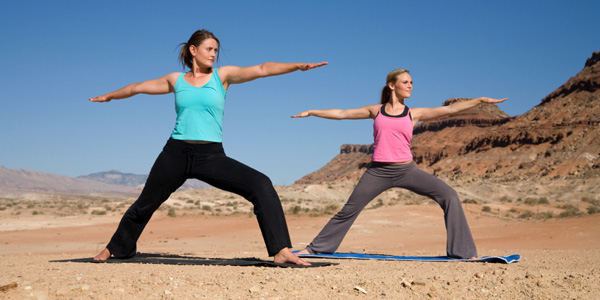 Two woman in yoga pose.