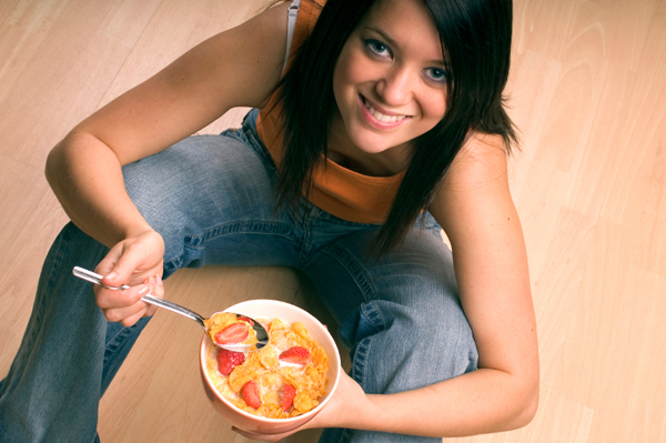 Woman with Cereal and Fruit