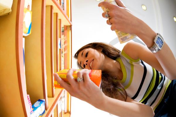 Woman Looking at International Groceries
