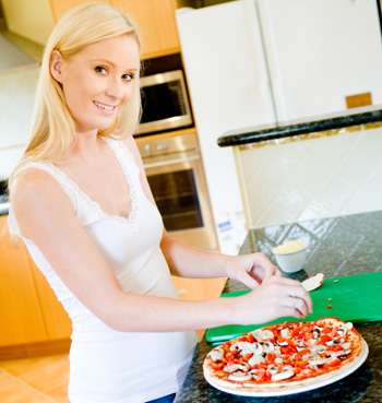 Woman Making Pizza