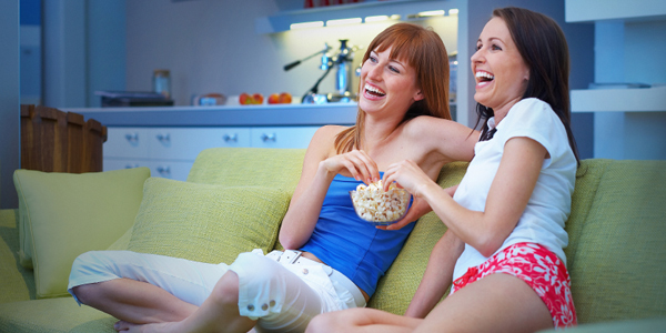 Woman on Couch Eating Popcorn