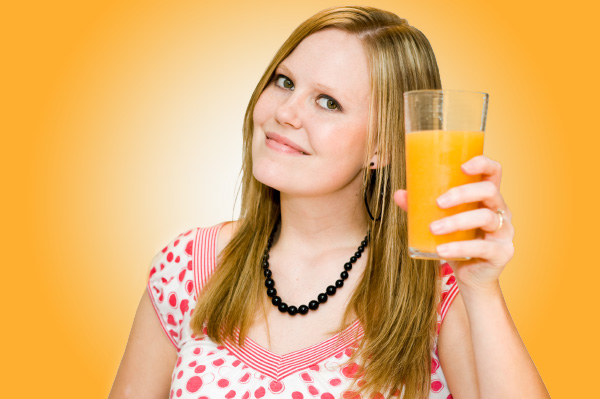 Woman with a glass of orange juice.