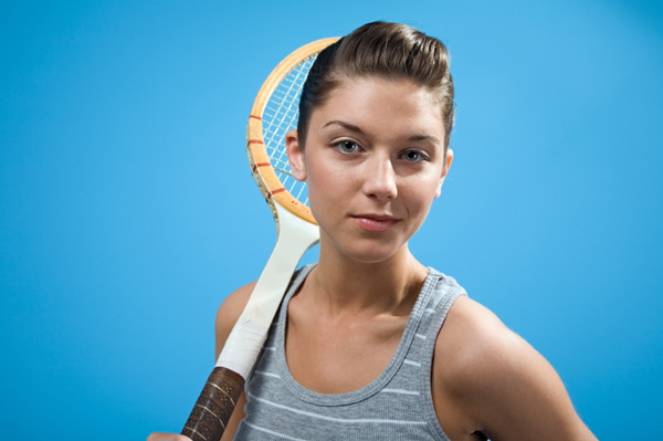 Fashionable Young Woman with Tennis Racket