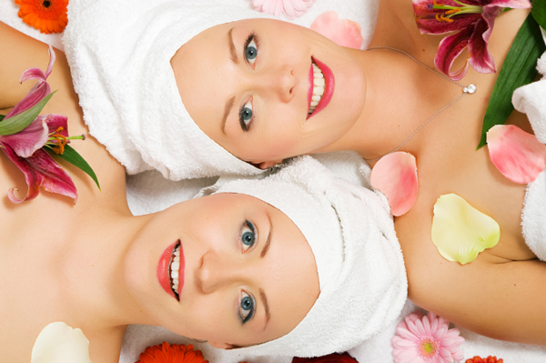 Two Young Woman Getting Spa Treatments
