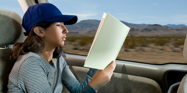 Girl Reading in Car