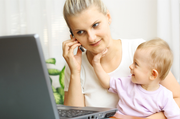 Mother at Computer with Infant