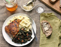 Crispy chicken thighs with braised kale and mashed potatoes