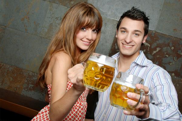 Cute couple having beers