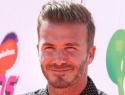 David Beckham crashes his motorcycle fleeing photographers