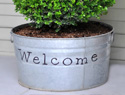 Spruce up your porch with this stenciled 'welcome' planter