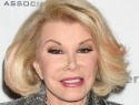 Doctors slowly bringing Joan Rivers out of medical coma